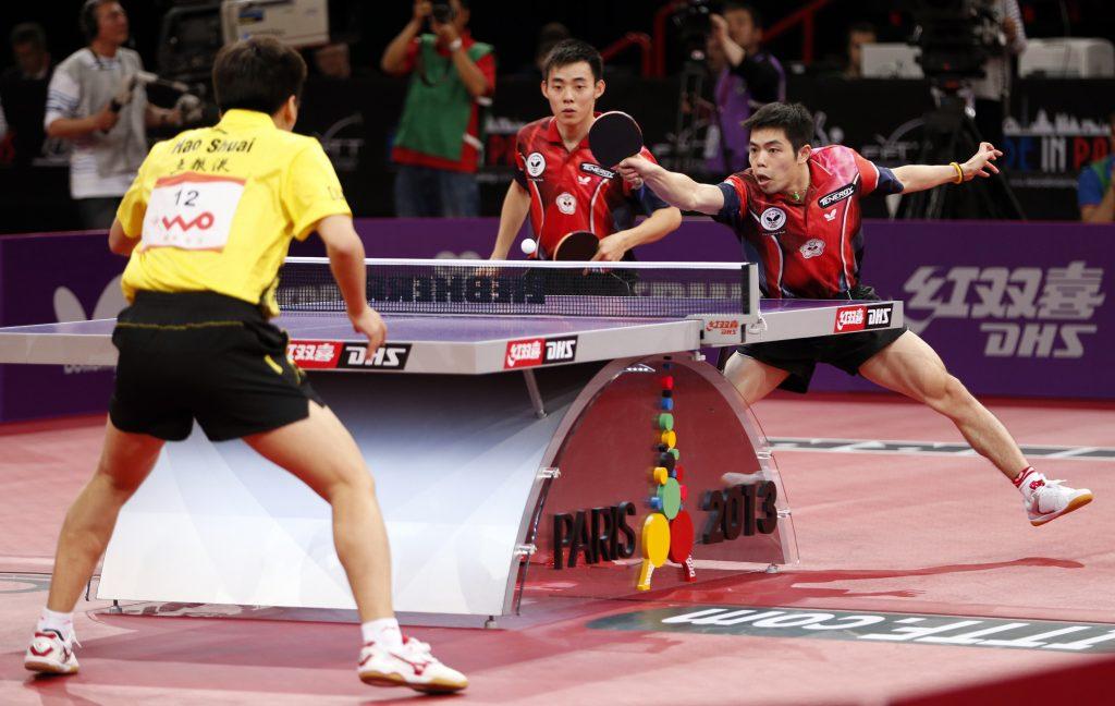 2013年世界卓球選手権パリ大会男子ダブルス決勝。陳建安は荘智淵とのペアで金メダルを獲得した。<br /> 写真:ロイター/アフロ