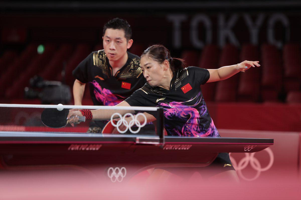 写真:許昕(シュシン)・劉詩雯(リュウスーウェン)の中国ペア/提供:ITTF